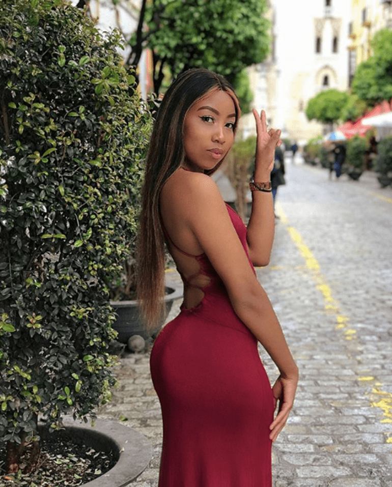 Bells in red tight dress